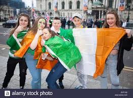 belfast uk 17th march 2015 youths wearing tricolour flags in