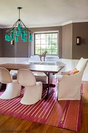 a modern bohemian dining room by design manifest pink rug blue
