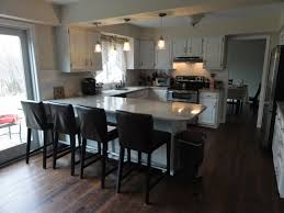 best 20 kitchen peninsula design ideas on pinterest small kitchen layout lovable white wooden and glossy marble top kitchen island with seating and u shaped white kitchen cabinetry set on woods flooring in small