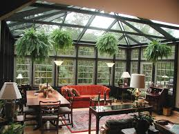 elegant glass sunroom designs with fireplaces and wicker chair
