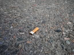file cigarette on asphalt jpg wikimedia commons