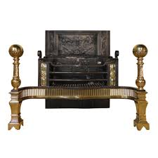 large regency cast iron and brass fire basket and andirons