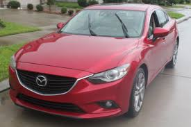 is mazda foreign buying a car as a single woman mazda6 grand touring review