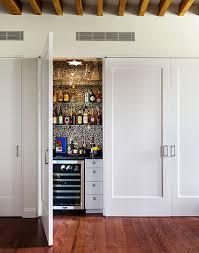 living room closet hidden closet doors design ideas