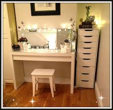 white makeup vanity table with lighted mirror and tall