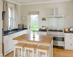 small square kitchen ideas transitional kitchen with square island and chandelier ideas