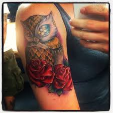 roses and owl on bicep