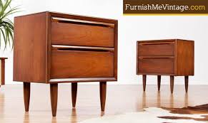 of minimalist mid century modern walnut nightstands