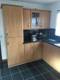 kitchen with hob oven extractor fan and intergrated fridge
