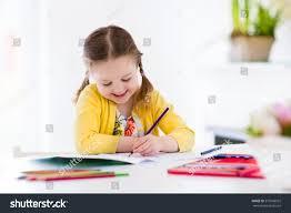cute little doing homework reading stock photo 373596925
