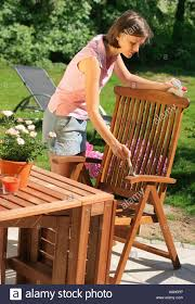 How To Oil Outdoor Furniture Woman Oiling Garden Furniture Stock Photos U0026 Woman Oiling Garden