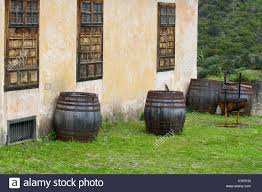 four wooden barrels standing in the backyard of old house in