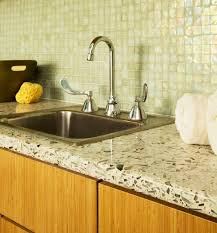 kitchen with mosaic backsplash and recycled glass countertops