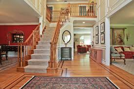 Wooden Banister Traditional Hallway With Crown Molding U0026 Bergere Chair In Katonah