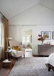 bedroom simple wing back chair next to sliding barn door modern