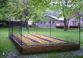 beautiful garden fence ideas design on the back yard using wooden