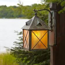 close up of exterior wall light on wood post brass light gallery