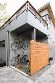 backyard cottage designs an exterior mud room and bike storage for this small backyard