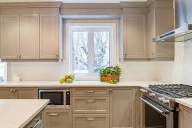 light gray kitchen with under cabinet microwave transitional