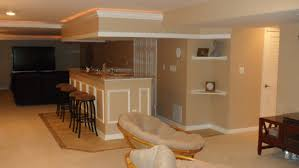 modern basement after remodel design with low ceiling and light