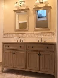 finished product walnut and ivory travertine bathroom