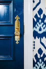 navy blue door with gold accent handle erica burns doors
