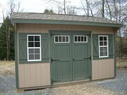 10x14 new england style cottage storage shed with shelving inside
