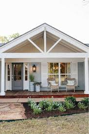 charming beach house exterior with covered front porch and wicker