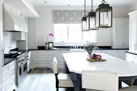 white kitchen with black island white kitchen island with black top black curved kitchen island