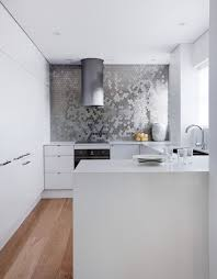 sparkling trend 25 gorgeous kitchens with a bright metallic glint stunning backsplash in kitchen karim rashid for alloy ubiquity tile in brushed stainless steel