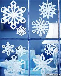 making paper snowflakes and garlands charming handmade christmas