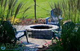 mattawan outdoor living area with fire pit landscape design and