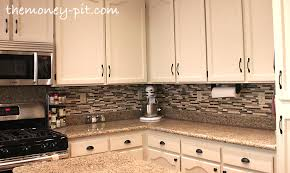 installing kitchen tile backsplash how to install a pencil tile backsplash and what it costs the