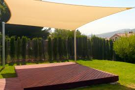 exterior patio deck sun shade sail with wooden deck floor with