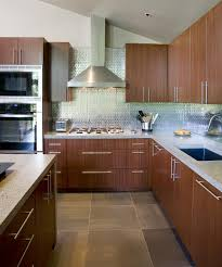 metallic tile backsplash with slate floor tiles and sapele