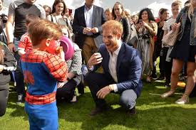 prince harry plays with boy as royals hold