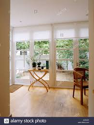 wooden flooring in modern white dining room extension with view of