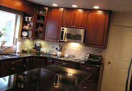 Small L Shaped Kitchen Remodel Ideas by Kitchen Enganging Small Kitchen With Shiny Black Countertops And