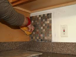 how to install glass tile kitchen backsplash kitchen installing kitchen tile backsplash hgtv how to install