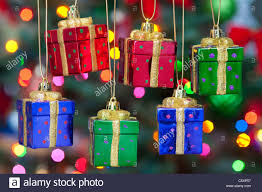hanging present ornaments on tree celebrating