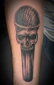 skull microphone tattoo on hand