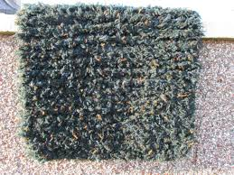 deep sea green with blue and orange flecks knitted rug