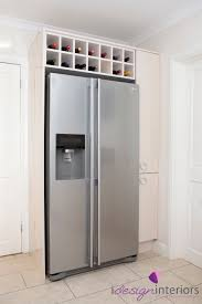 american style fridge freezer with surrounding gloss cream units