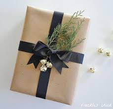 rustic christmas wrapping paper gift wrapping kraft paper jingle bells black ribbon