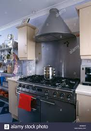 up modern kitchen close up of conical extractor above black range oven in modern