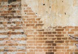 exposed brick red clay stained on the white exposed brick concrete wall stock