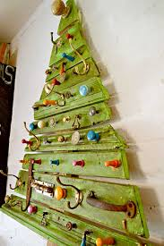 unique diy wooden tree with knobs on pillar box blue