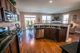 floor and decor denver furniture dark brown aristokraft cabinets on wooden floor plus