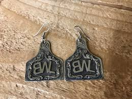 cow tag earrings cow puncher