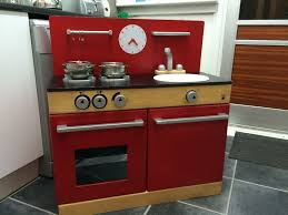 john lewis red wooden play kitchen with ikea pots and pans set